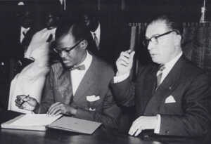 Lumumba and Eyskens sign the document granting independence to the Congo (source: Wikipedia)